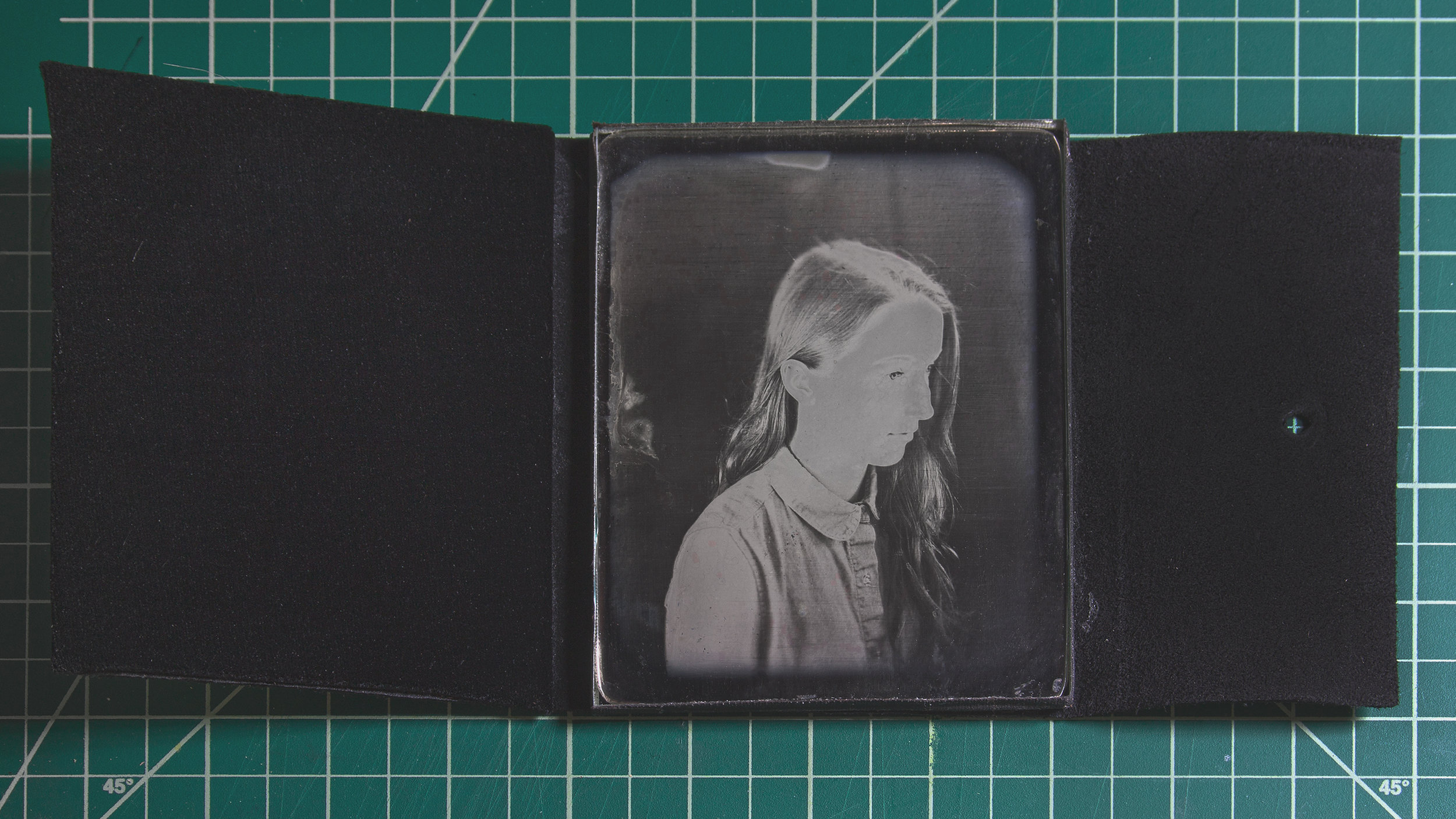 A contemporary Daguerreotype in a suede case with a velvet vieweing pad.
