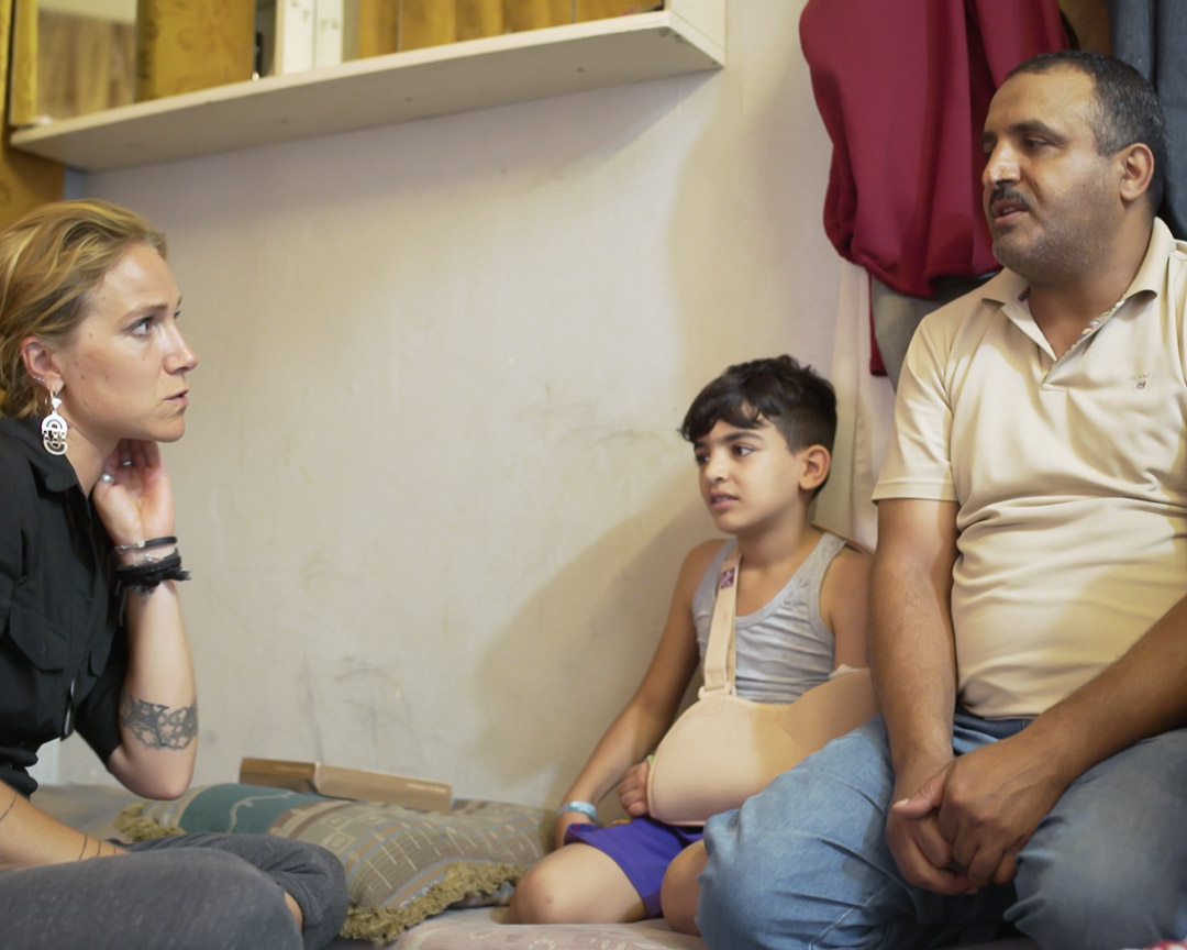 Founder Arwa Damon with Mounir and his father.