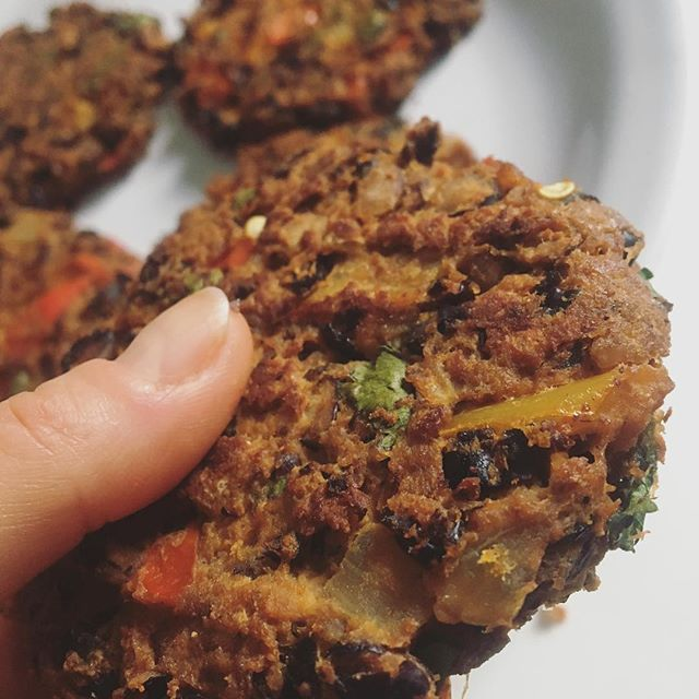 My test kitchen has been filled with grab-and-go experiments to work with my crazy schedule, and these black bean veggie burgers are making their way into the official weekly lineup (and cookbook). They may not look like much, but don't let their humble ways fool you — they are nutrient dense superstars. Filled with protein, healthy fat, fiber, and lots of phytonutrients, they are not only gluten, dairy, and crap free, they are flavorful, satisfying, and delicious over a salad, in a wrap (like my homemade tortillas), or solo like a giant savory cookie 🍪 They'll keep you full, energized, keep your blood sugar balanced, and make your microbiome super happy. Did I mention how cost effective, easy, and efficient they are? They're a great way to use bits and scraps of leftover veggies — and for you juicers, the perfect way to use up that pulp. Mix and match different beans, herbs and spices for endless options. Get in that kitchen and play!