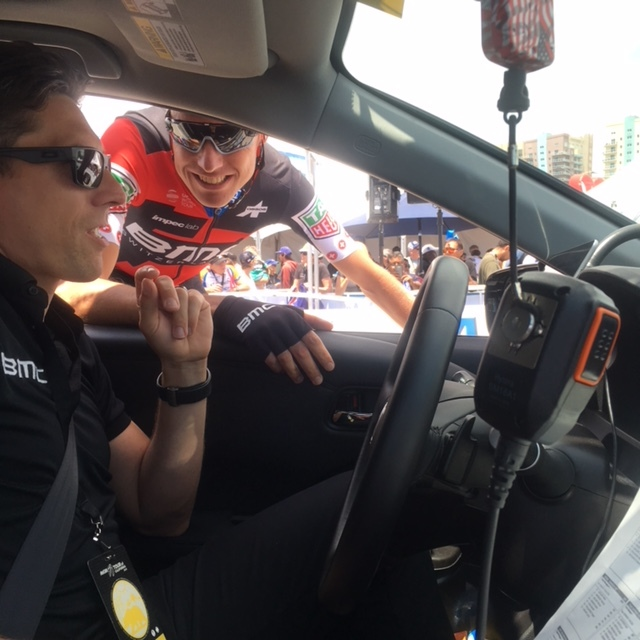 Riders come back to the team car throughout the race to grab hydration & nutrition.
