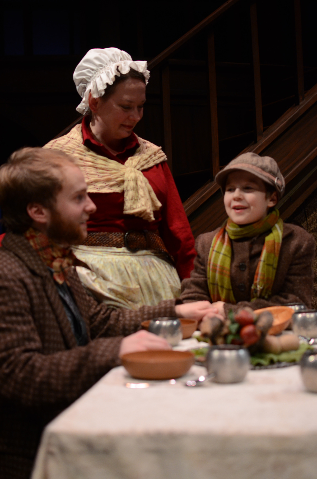Nate Stahlke, Kathy Logelin, and Noah Chacon in A Christmas Carol (2013). Bettencourt Chase Photography.