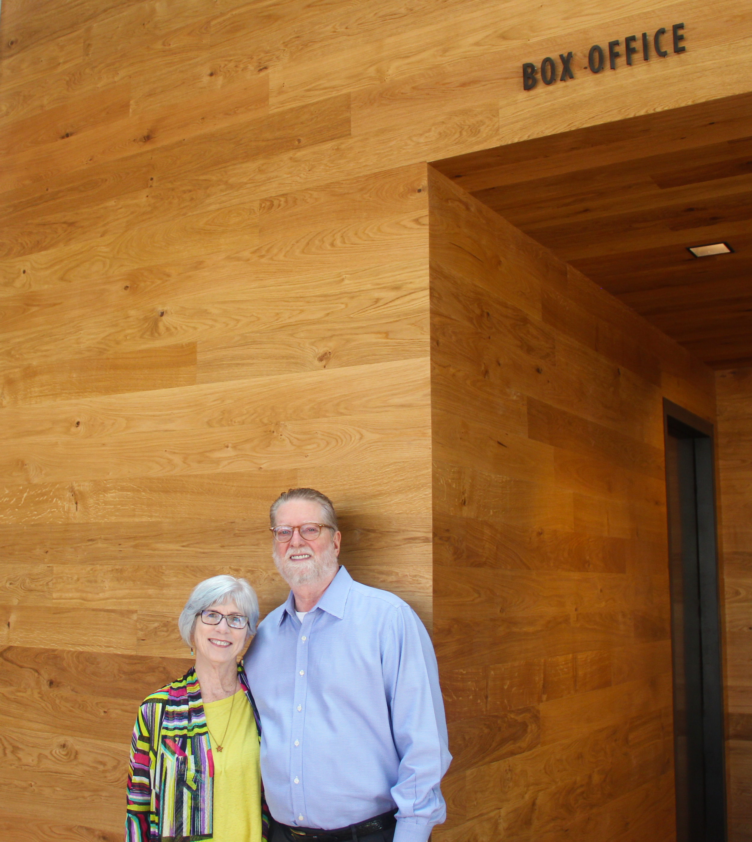 Lynn and Joel Carver in front of the Carver Box Office