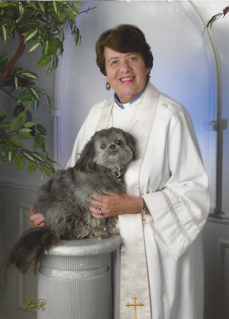 Cynthia Crosson-Harrington and her service dog for ministry, Dandi.