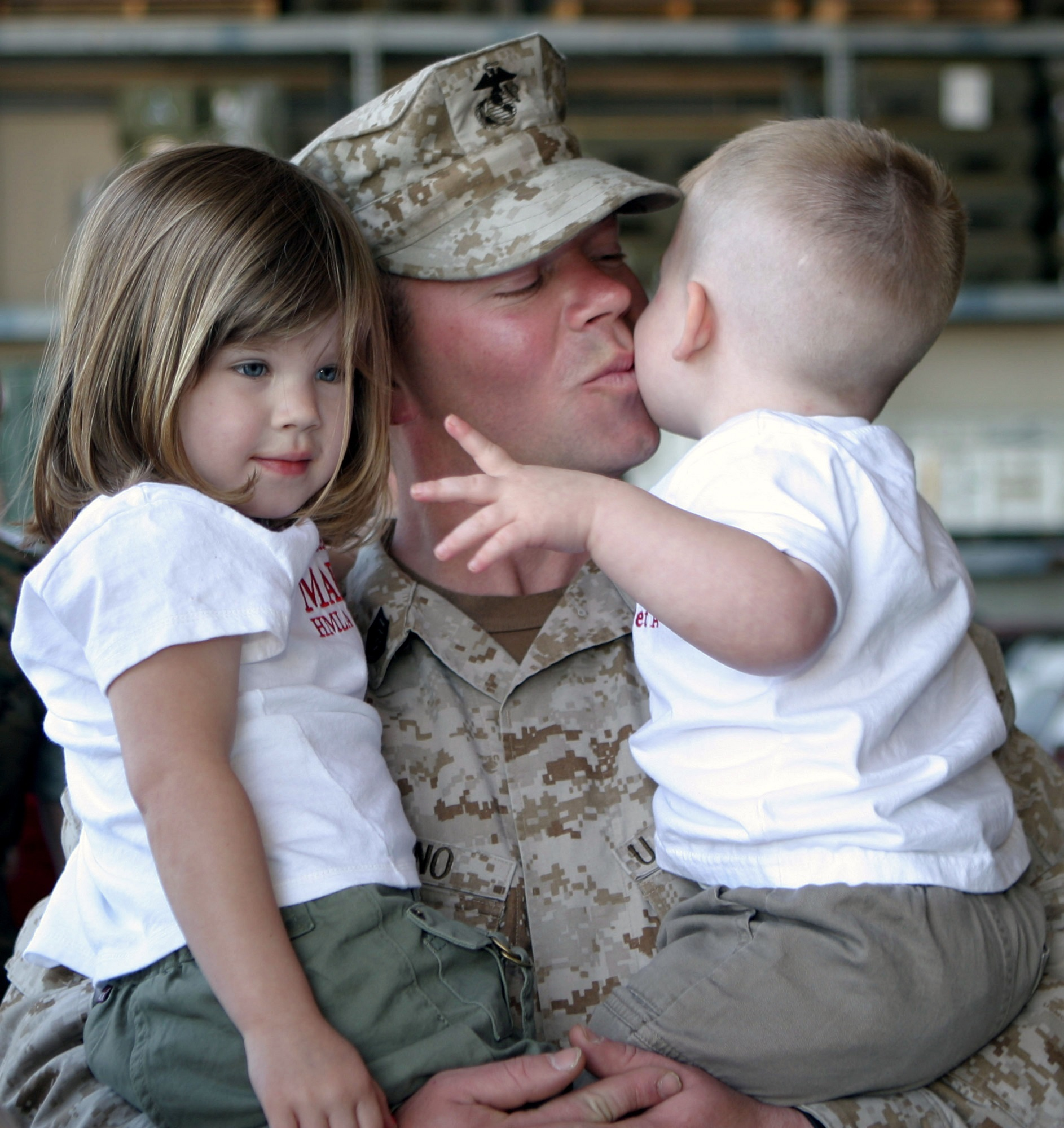 soldier kissing kids.jpg