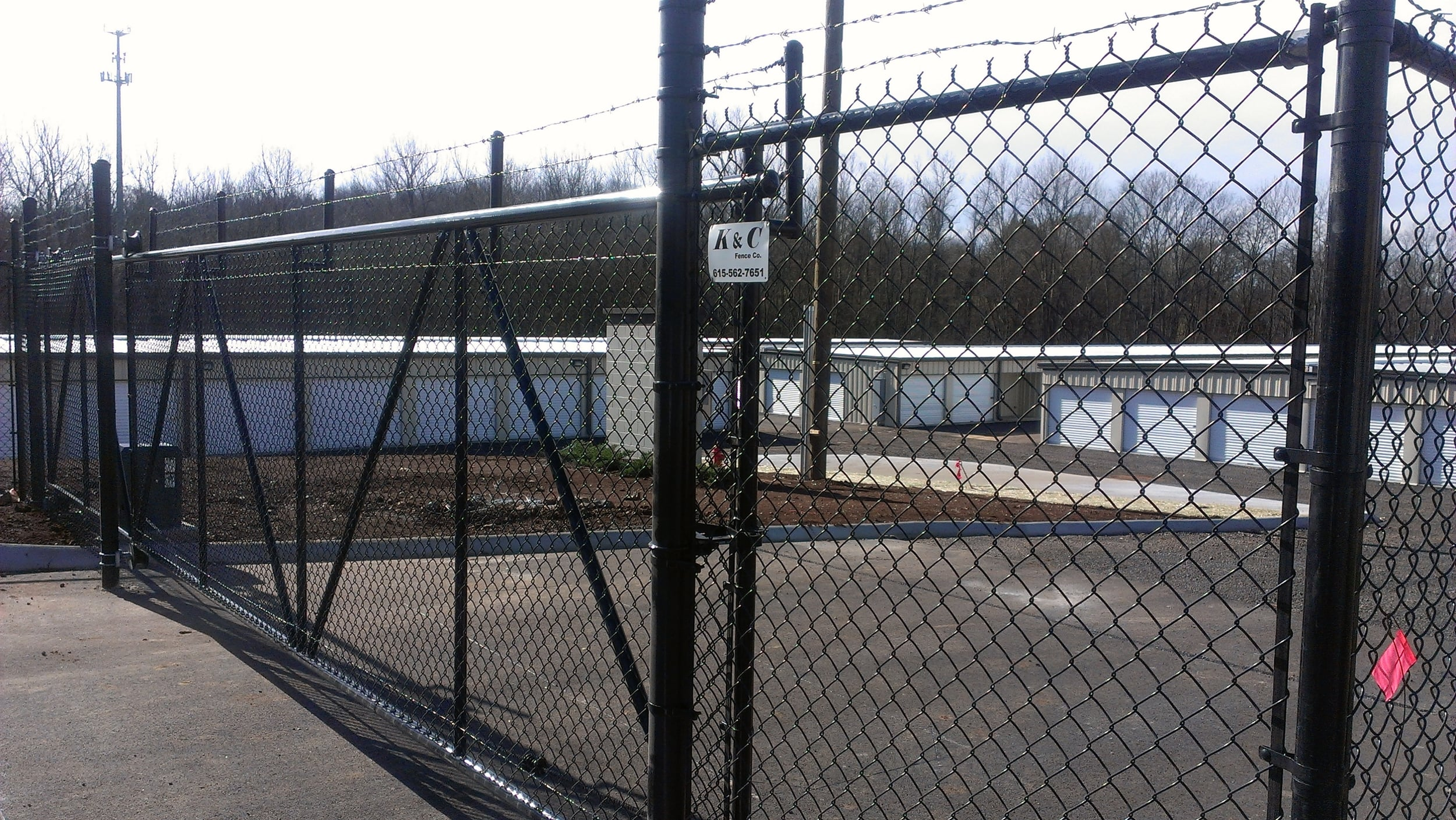 Black Vinyl chain link commercial fence installed in Nashville by K & C Fence Company