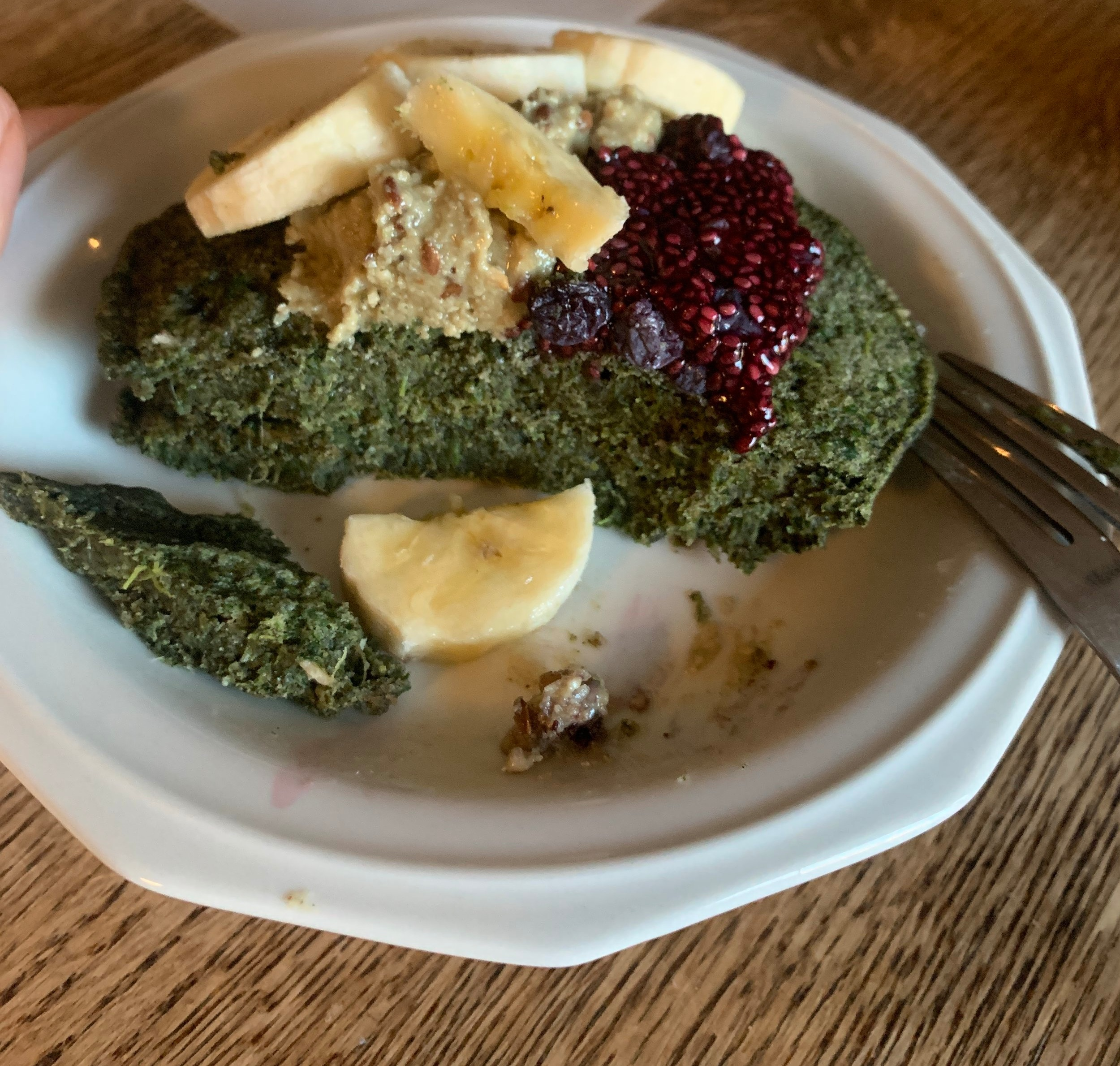 Spinach buckwheat pancakes with bananas, chia jam, and nutseed butter