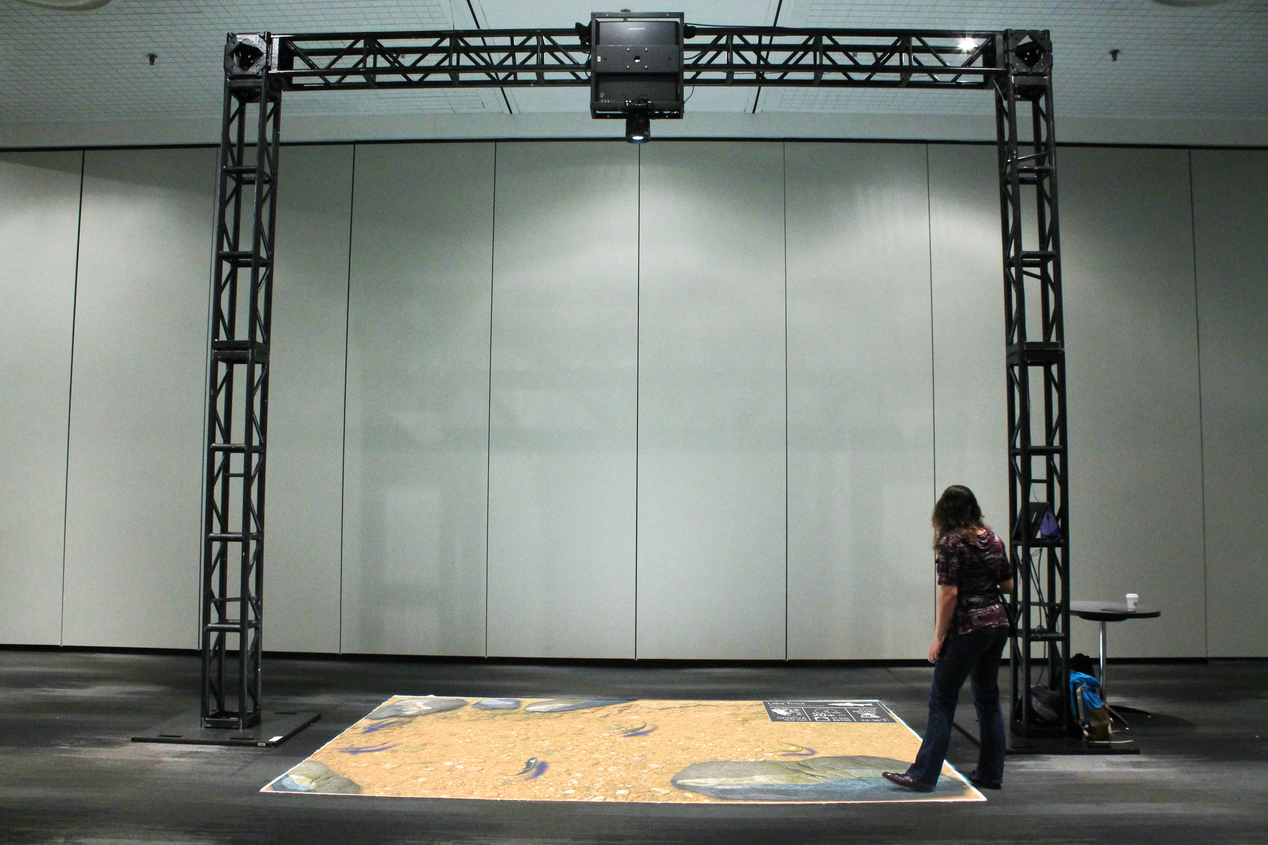 Interactive educational floor at the Javits Center in NYC using a 5000 lumen projector on an arch truss mount. (Lumo Play)