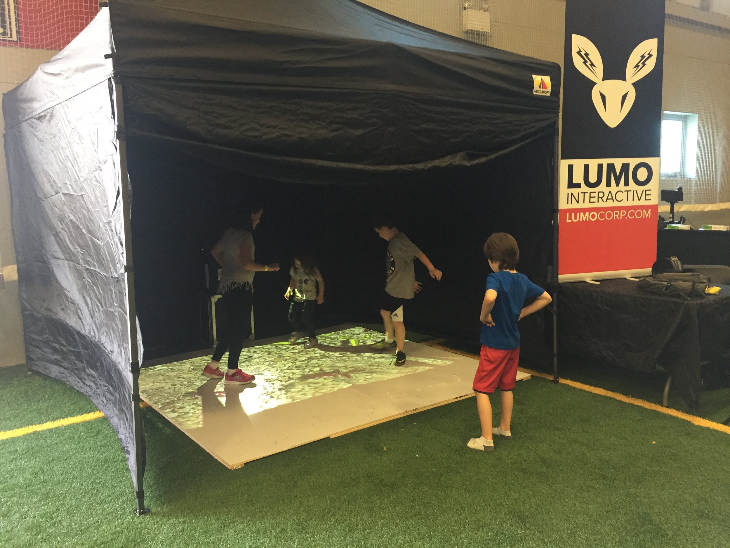 Lumo Play pop-up interactive floor installation at a special needs fundraiser in Toronto