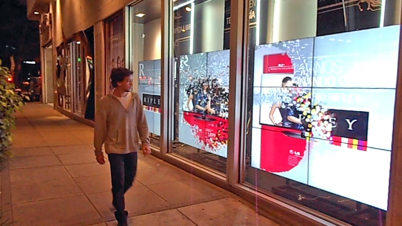 An example of an exterior facing store window with a Lumo Play effect, made with the  Breakapart Motion Maker Template .