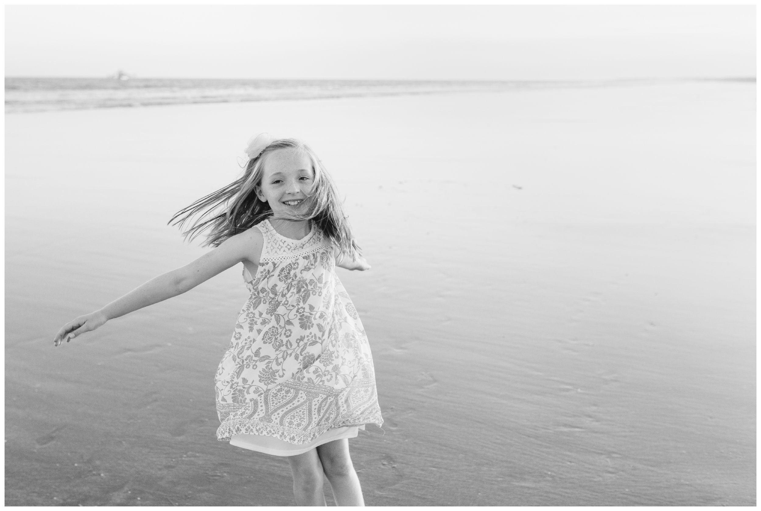 laughing sister twirling in the sand