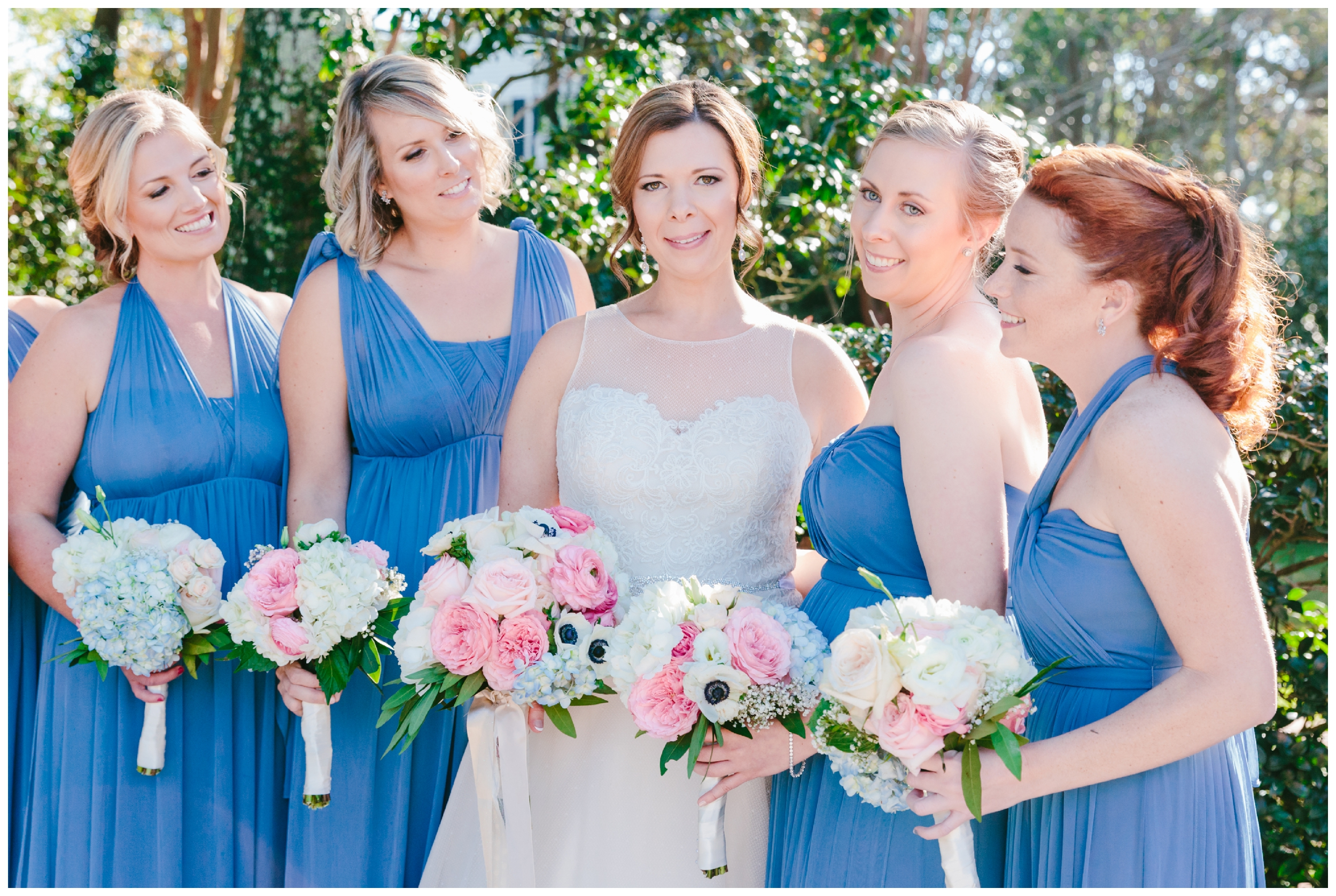 bride with her bridesmaids in their slate blue dresses