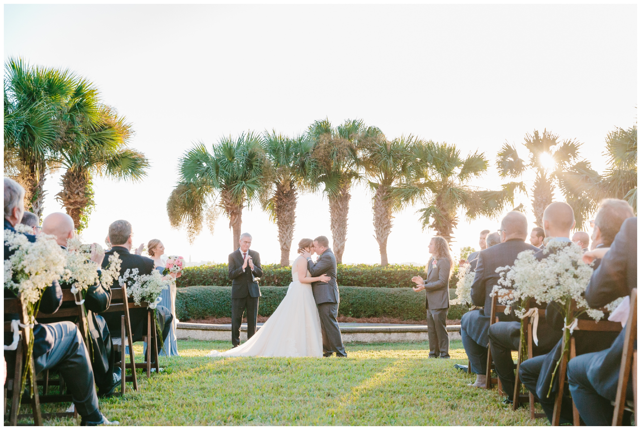 first kiss on the lawn of harborside east in mt. pleasant.