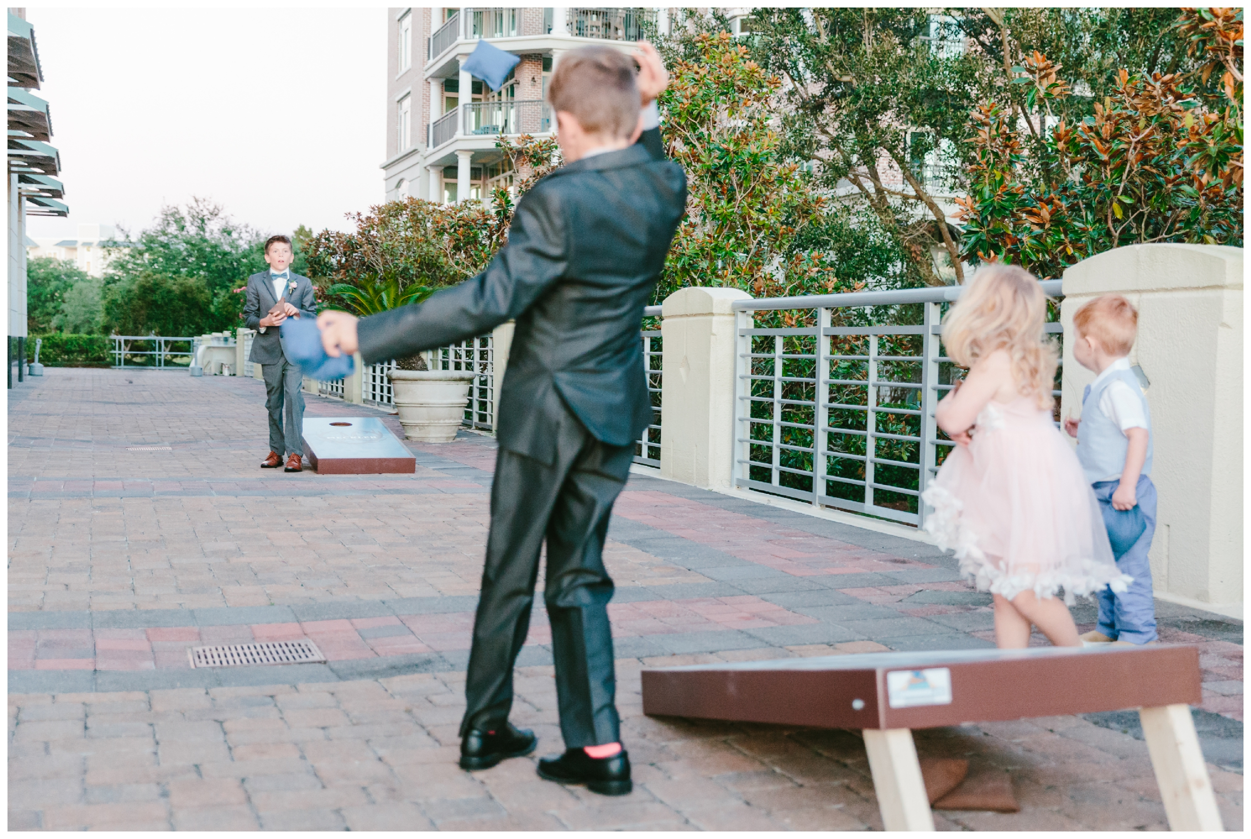 kids playing corn hole during the reception at harborside east.