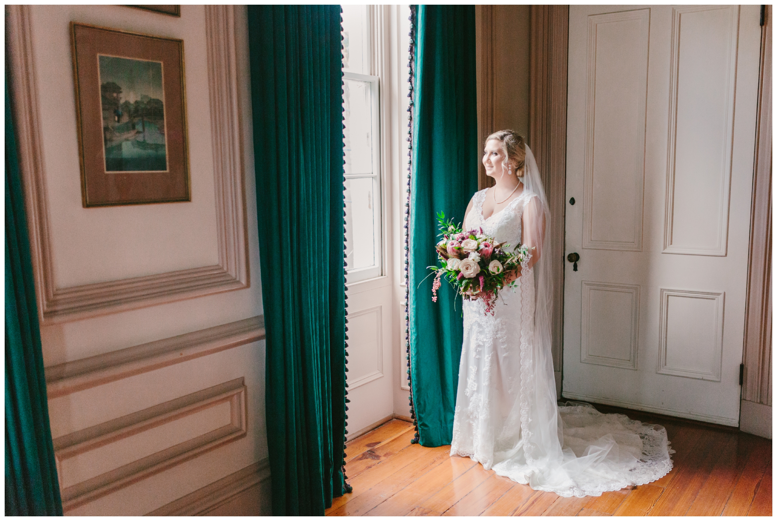 bridal portraits at mcbee house on the ashley hall campus.  floor to ceiling windows with teal treatments