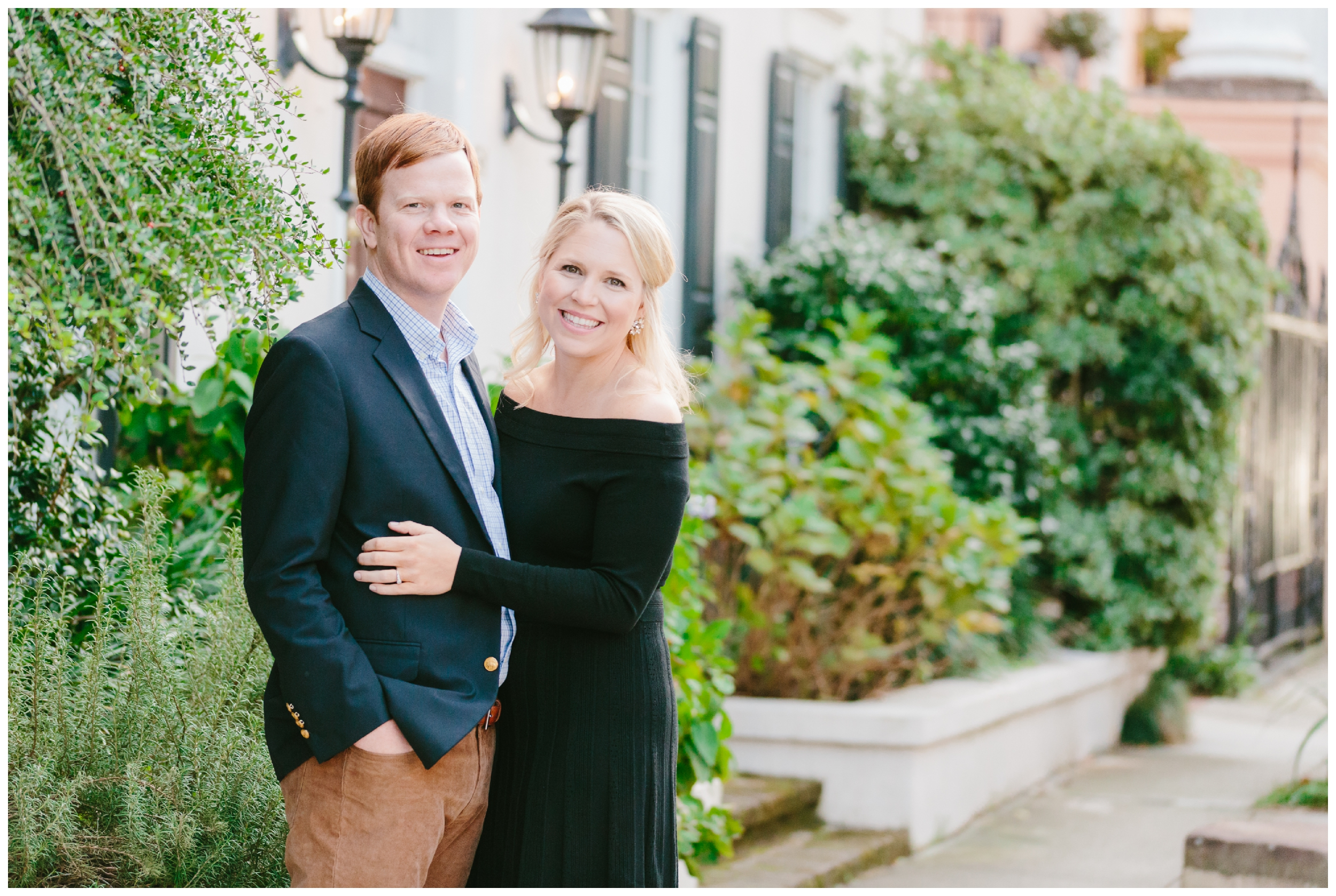 couple embrace and smile at the camera for their engagement session