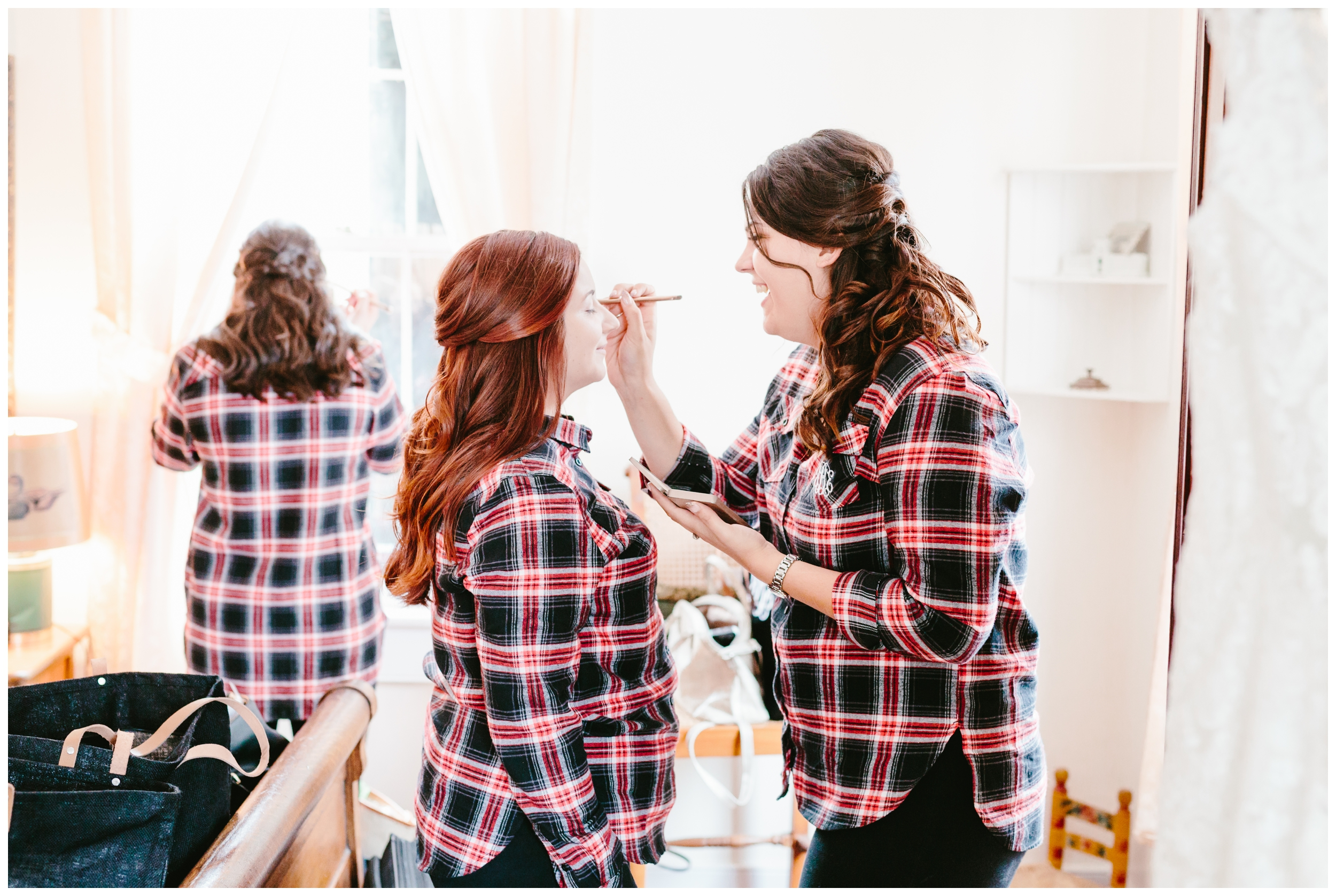 the bridesmaids were helping each other with their make-up.