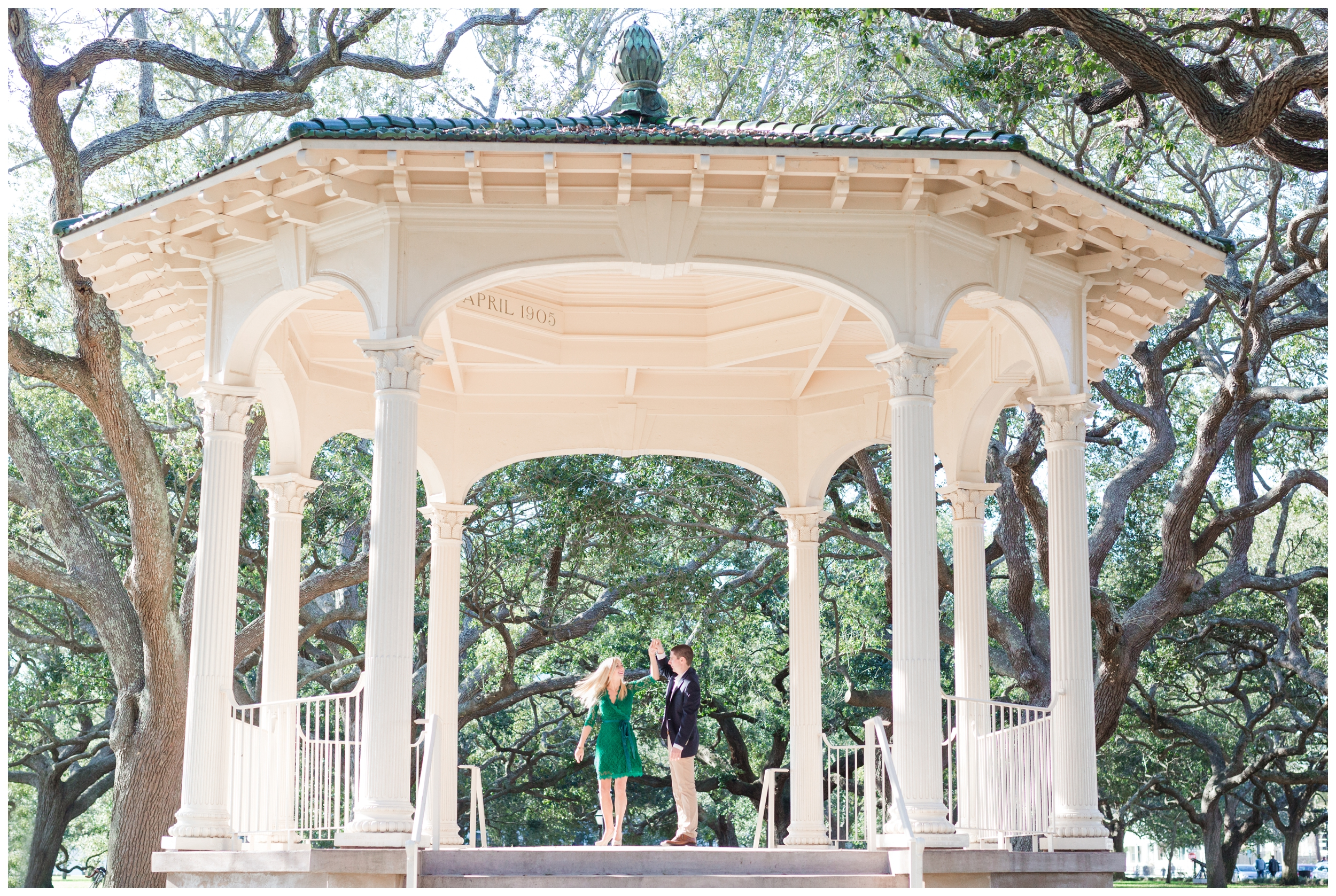 bride and groom practicing their twirl under the gazebo