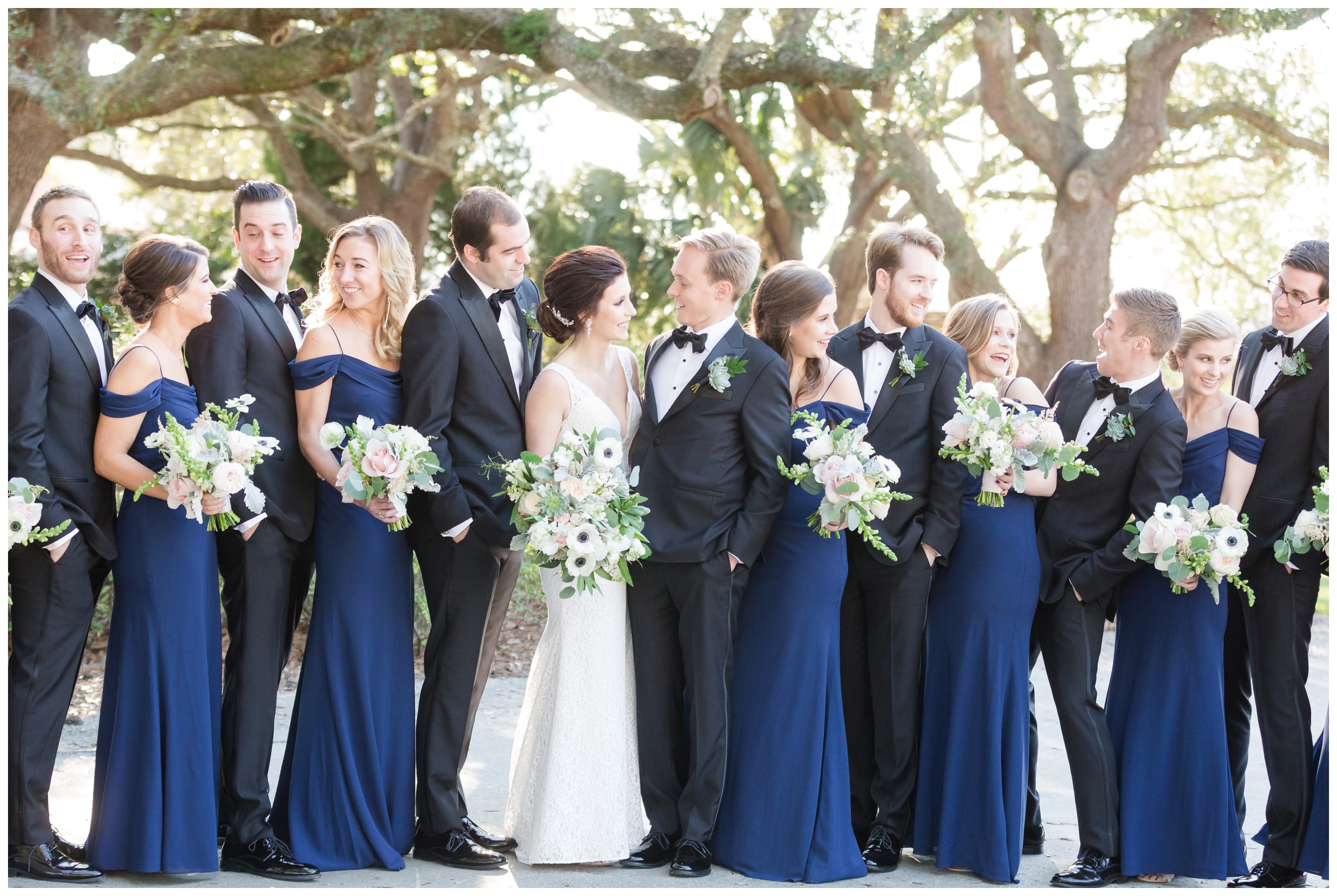 wedding party laughing with the bride and groom