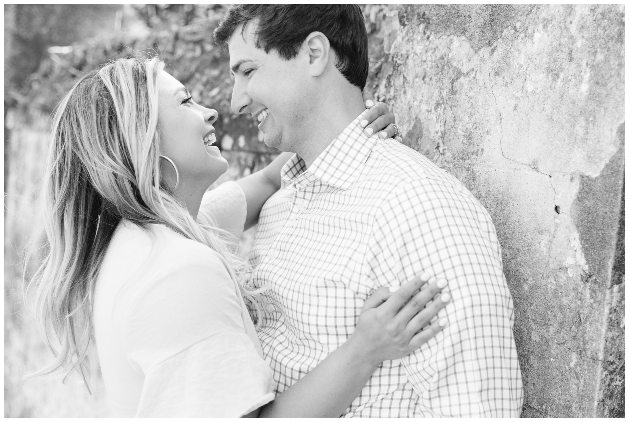 bride and groom laughing during their engagement session