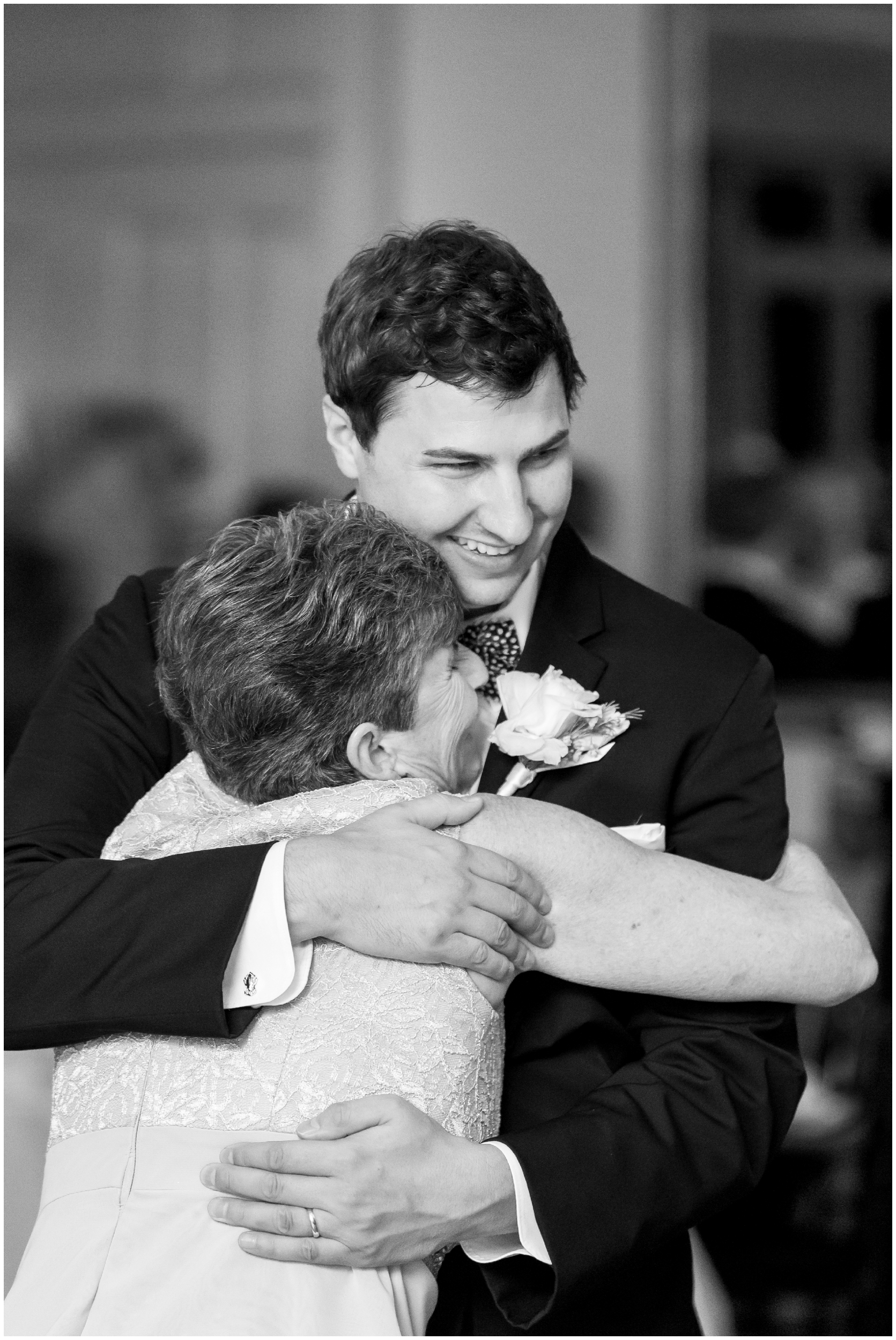 groom and mother of the groom share a sweet embrace during their dance