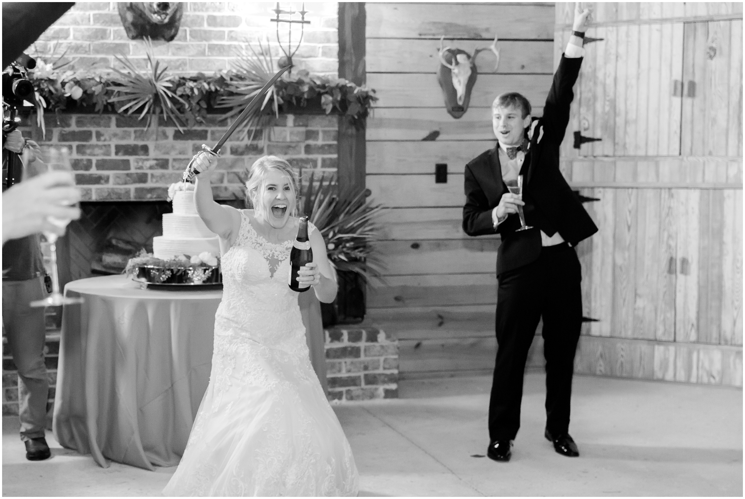 successful saber of champagne by bride
