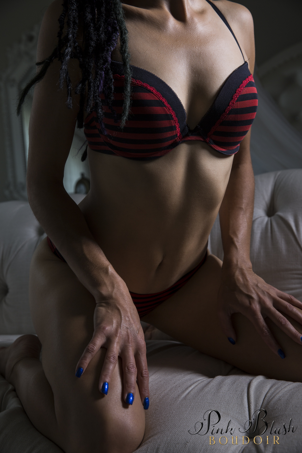 Boudoir Photography Edmonton, a woman's body dramatic lighting black and red bra and panty set