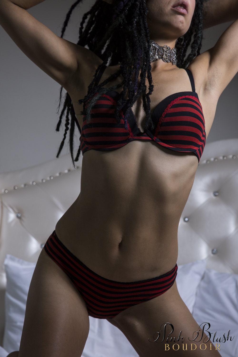 Boudoir Photography Edmonton, woman's body in a black and red striped bra and panty set