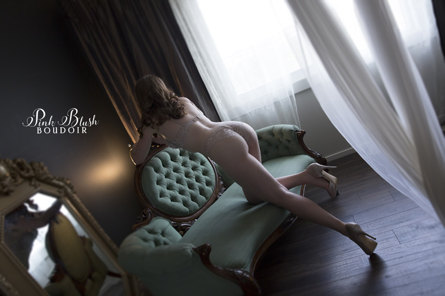 Edmonton Boudoir, a woman leaning over a green couch
