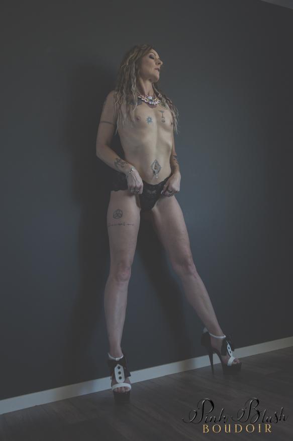 Edmonton Boudoir, a woman standing topless