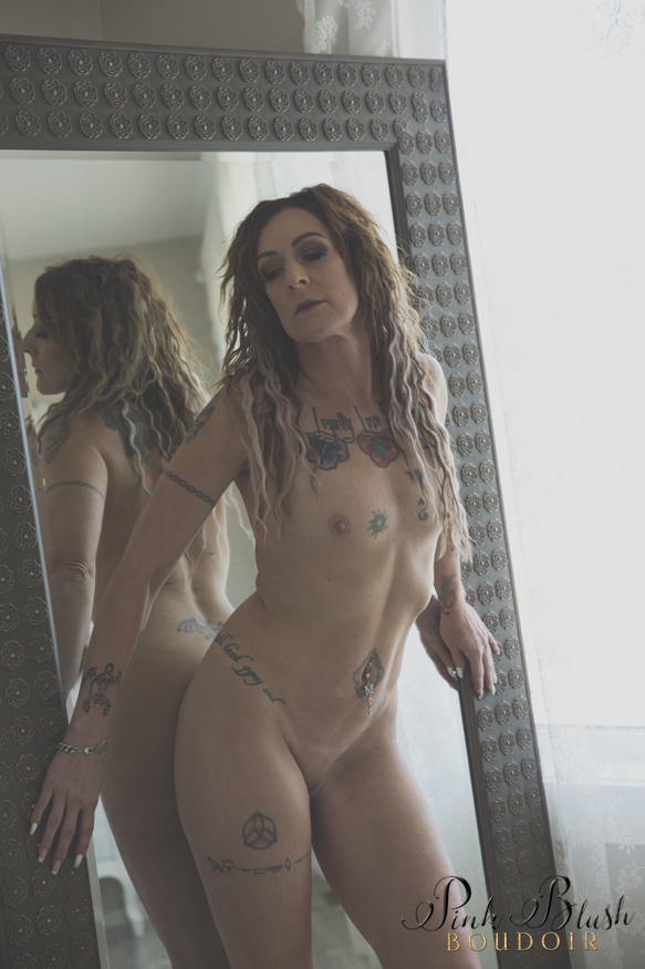 Edmonton Boudoir, a woman standing naked in front of a mirror