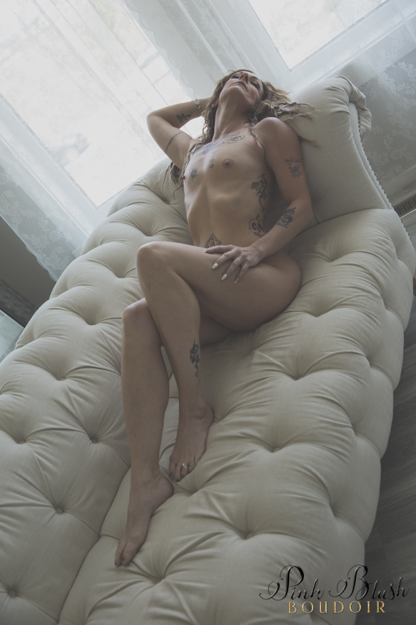 Edmonton Boudoir, a woman laying naked on a white couch