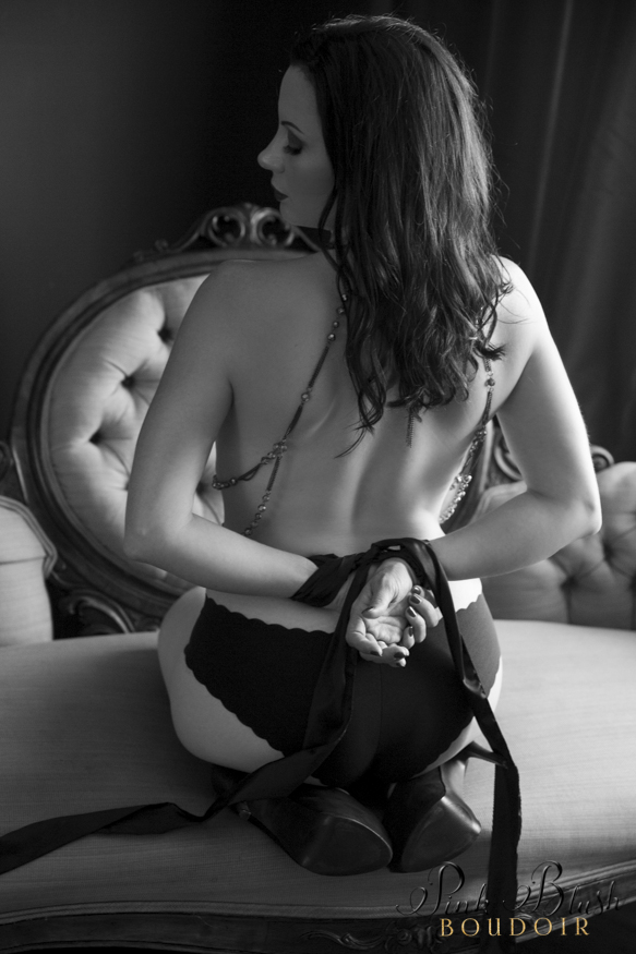 boudoir photos, a woman with her hands tied up behind her back