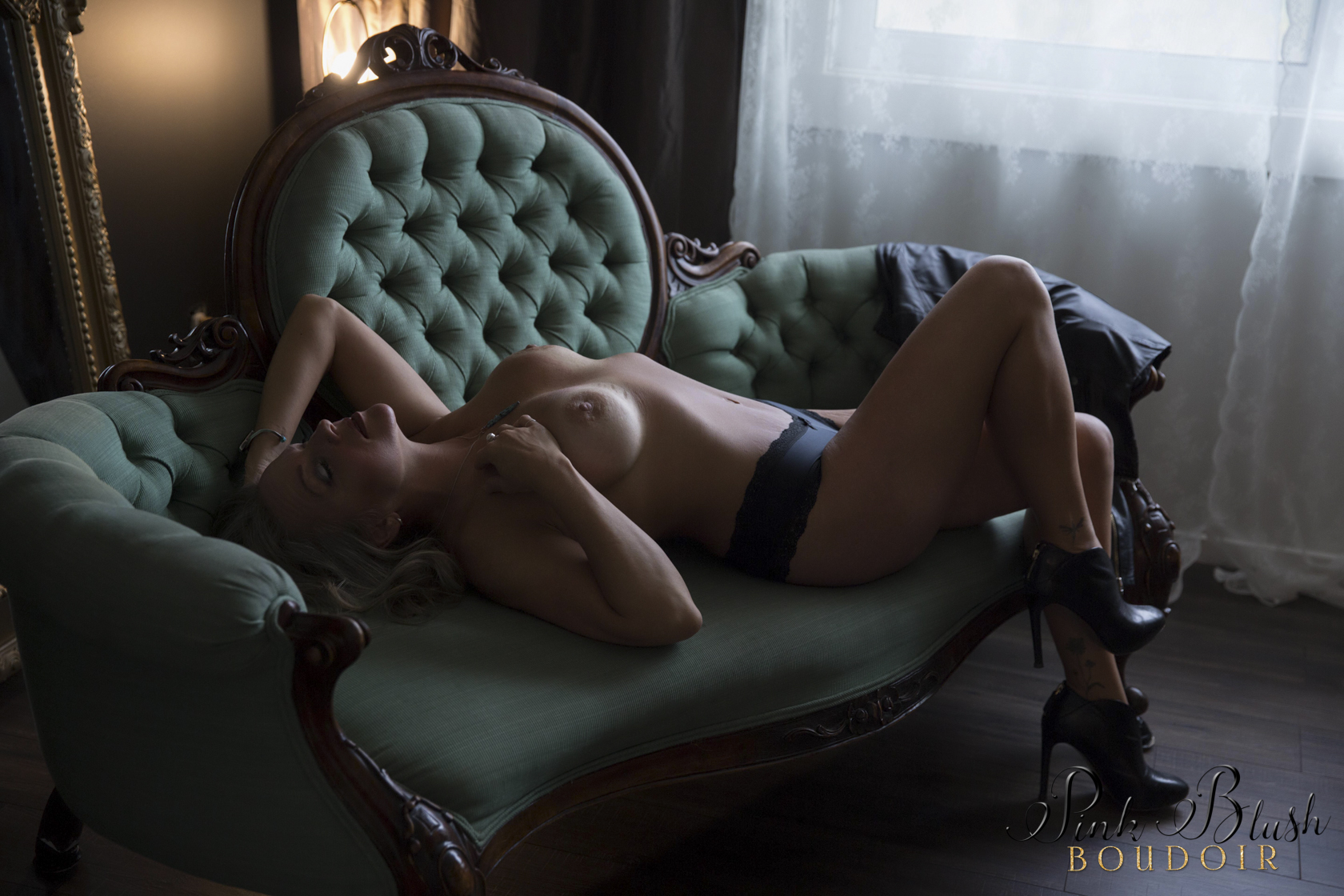 boudoir photos, a topless woman on a green couch