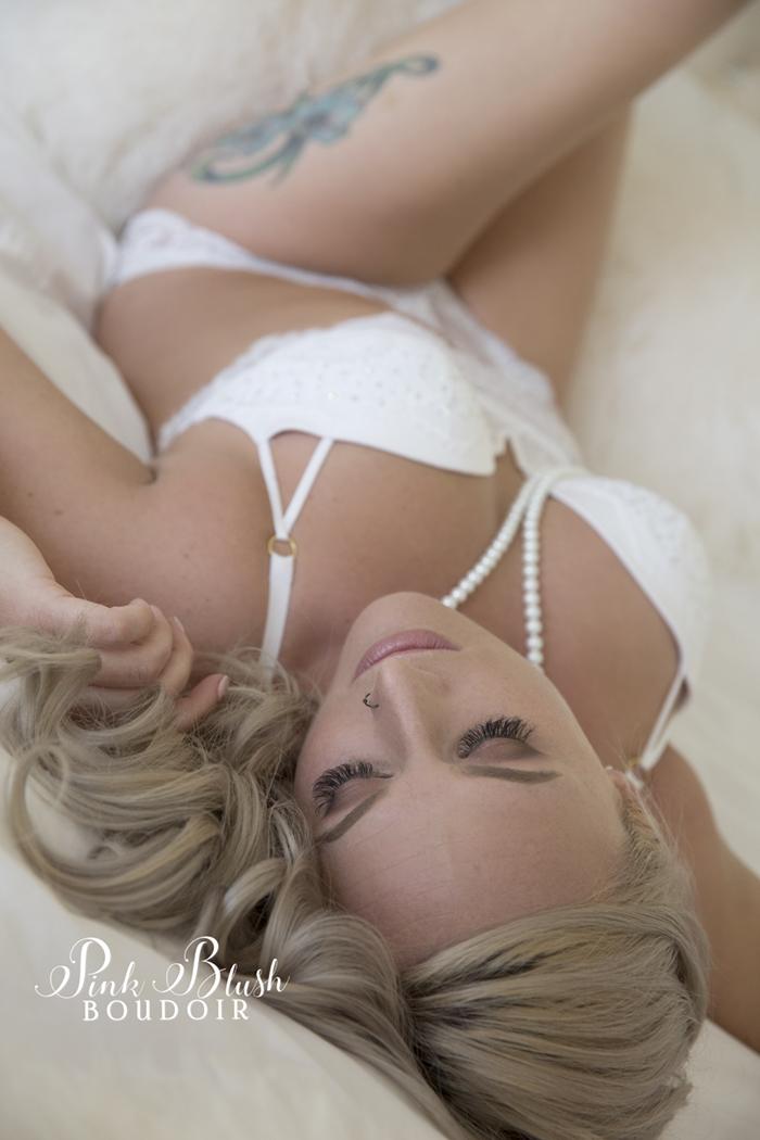 Boudoir Edmonton, a woman in a white bra and panty set