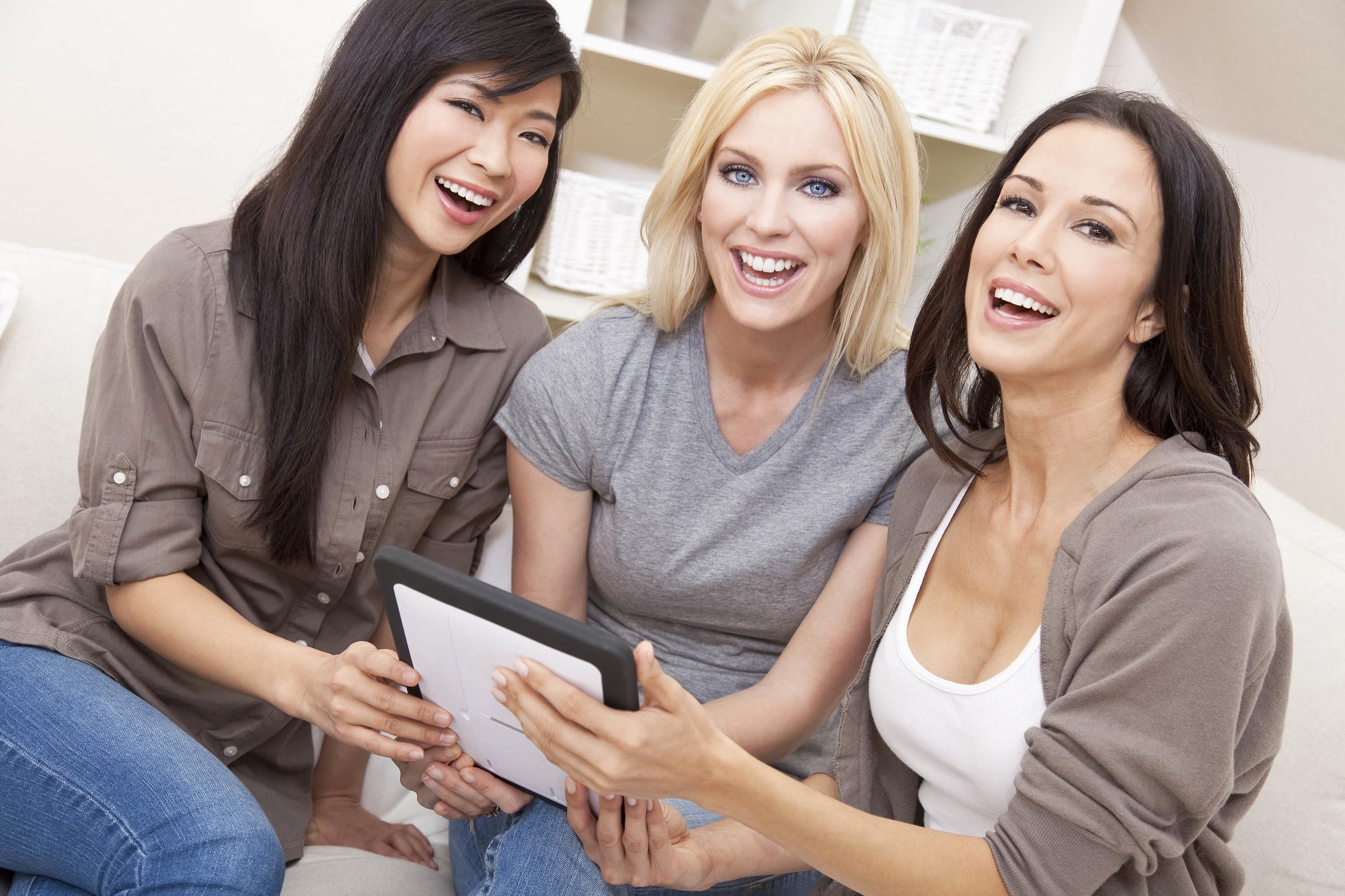 3 smiling women watching ipad.jpg