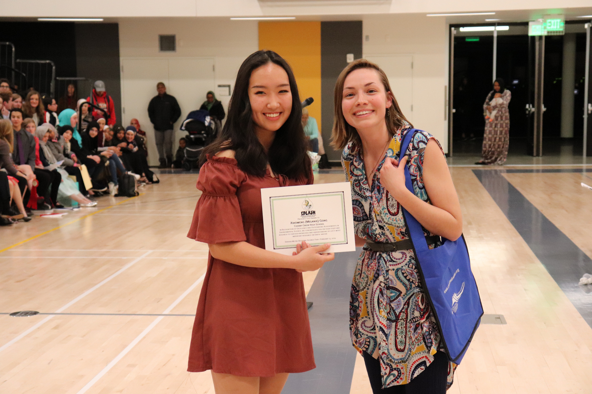 """Stormwater Permittees for Local Awareness of Stream Health (SPLASH) awarded Xiaomeng (Melanie) Gong, Cherry Creek High School, for her project """"Biodegradation of Environmental Waste Utilizing Edible Fungi""""."""