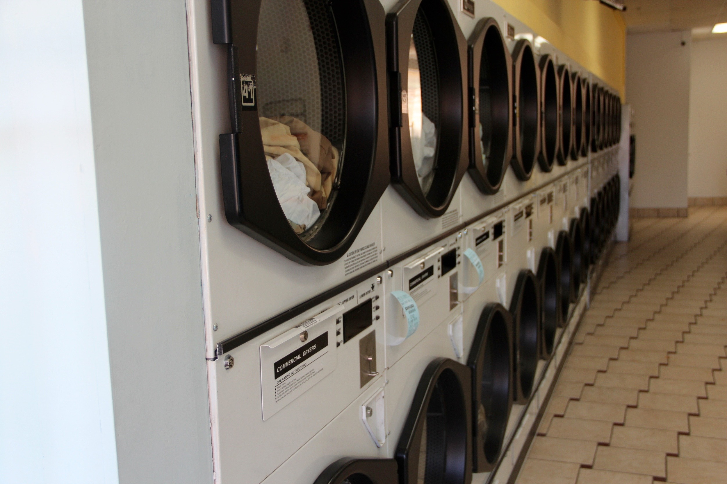 A row of dryers at Rainbow Laundry MPLS in Uptown Minneapolis, MN.  Rainbow Laundry MPLS Laundromat Dry Cleaning Wash & Fold Alterations   Michael Mike Kulik MKtechMPLS MKtech