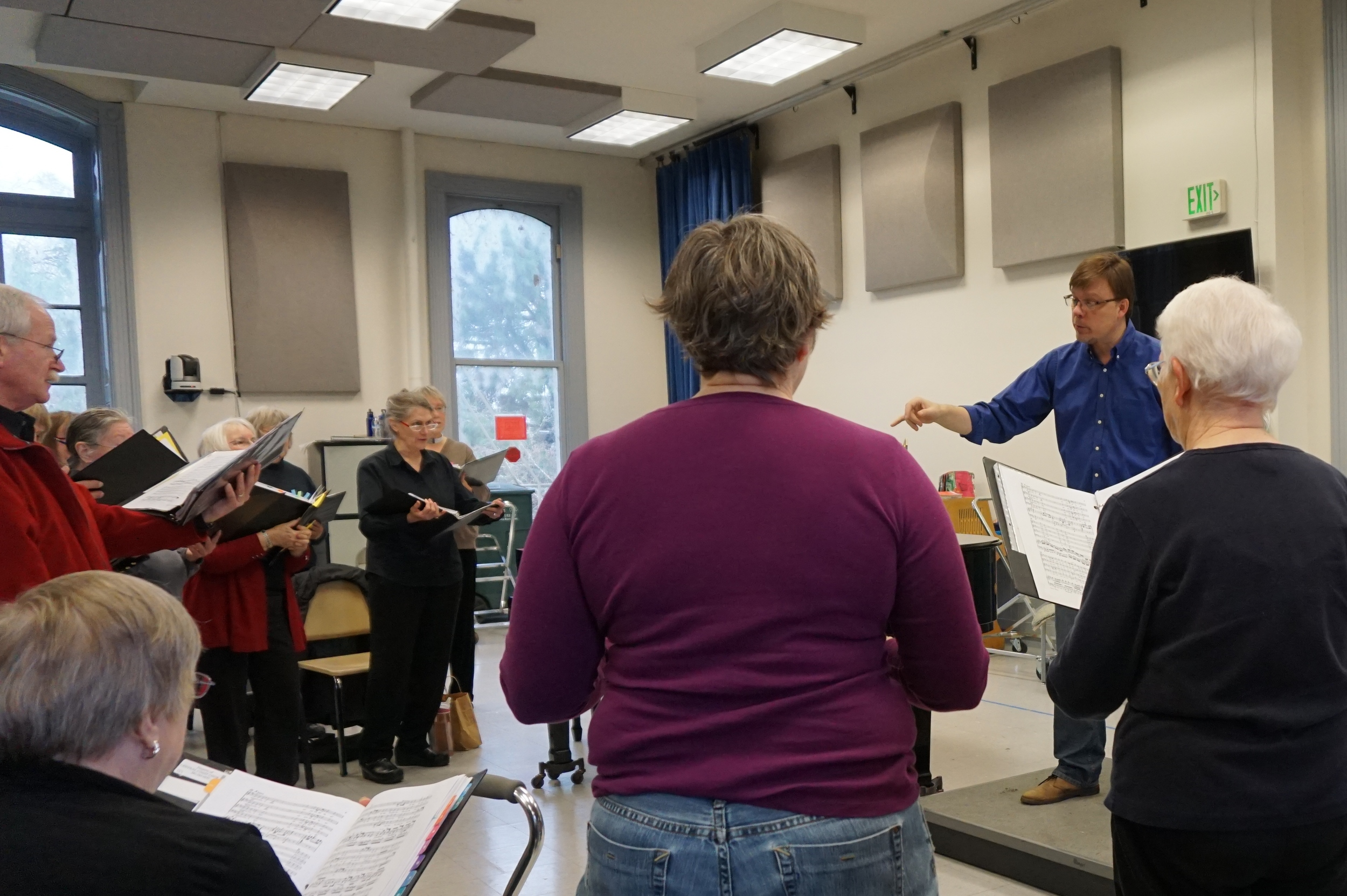 Dr. Steven Zielke conducts rehearsal with the central coast chorale in preparation for holiday spectacular concert.