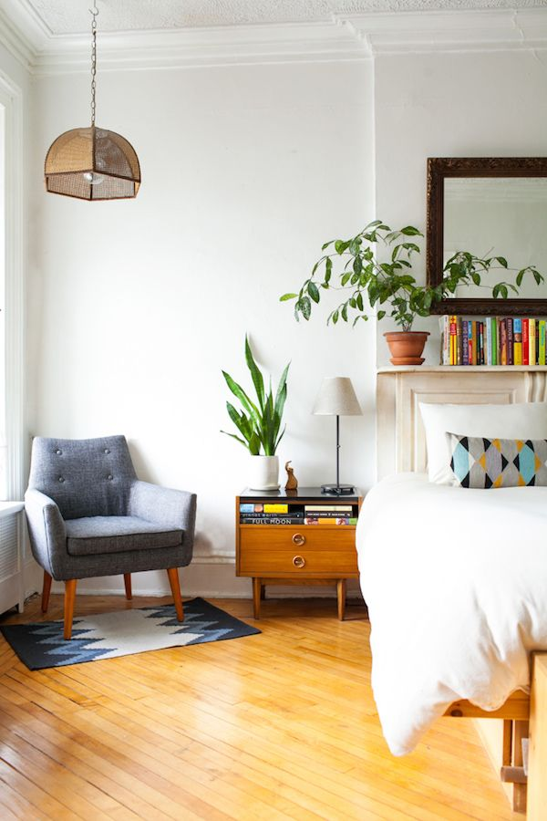 Live plants, warm earthy shades (green, blue, and brown) can liven up a space while still looking effortless. ( source )