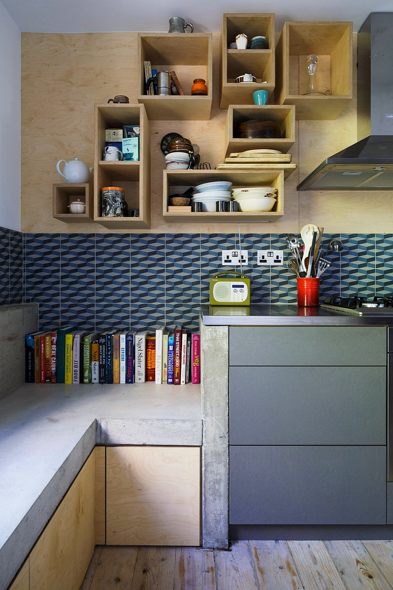 Unique geometries and bright contrasting colors really make this space feel comfortable and friendly. ( source )