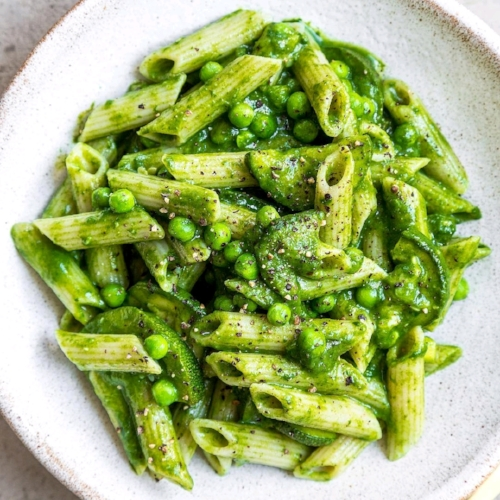 Pea and courgette pasta with a creamy spinach sauce