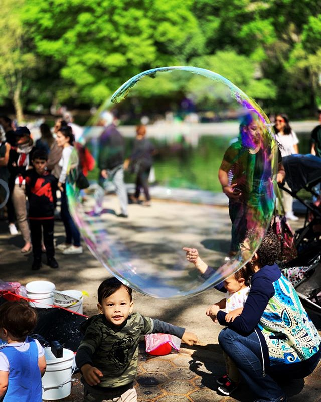 Chasing bubbles in Central Park.