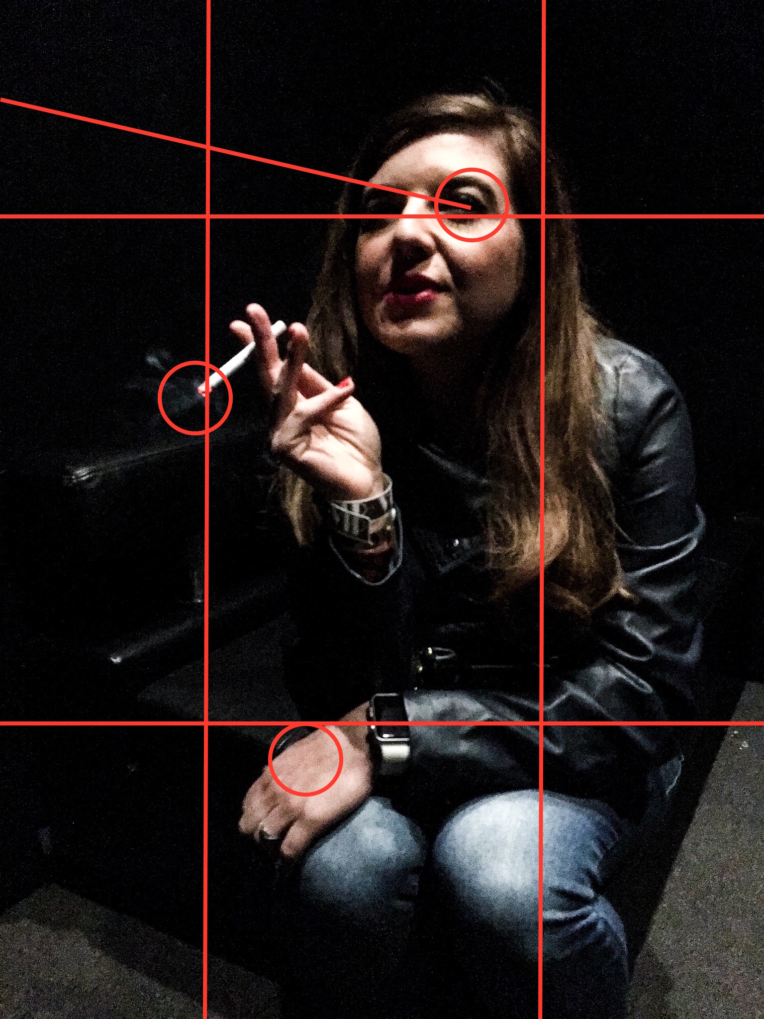 I created an overlay of lines and circles to highlight why I think this image was interesting. The eyes are close to the top right intersection in the rule of thirds. The cigarette falls on the left third of the image and the hand on the bottom third of the image. The eyeline is on an angle off camera looking to something, creating interest. The lighting contrast, the dark shadows and bright spots create interest.