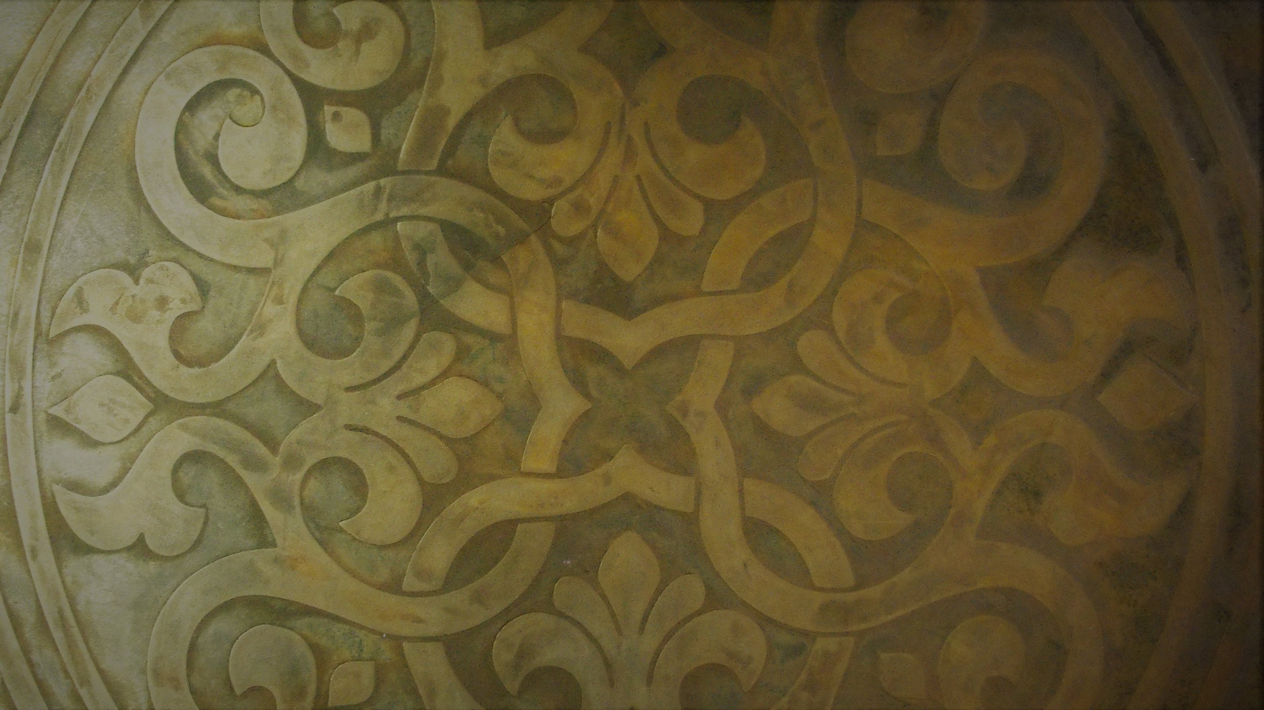 Embossed patterns can be slightly recessed or raised with the use of various plasters and techniques to enhance the pattern. The grey sample image below captures a recessed pattern that is a fairly smooth, tone on tone pattern with burnished edges. The above picture shows a raised pattern on a Lusterstone ceiling. Endless options for pattern, texture and overall look.