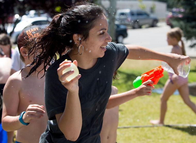 KATIE HARTWIG/CDA Press - Nica Guinasso, age 19, of Coeur d'Alene enjoys times with the kids on water day at the Boys and Girls club in Post Falls, Friday. Guinasso is one of the 24 Americorps volunteers this summer.