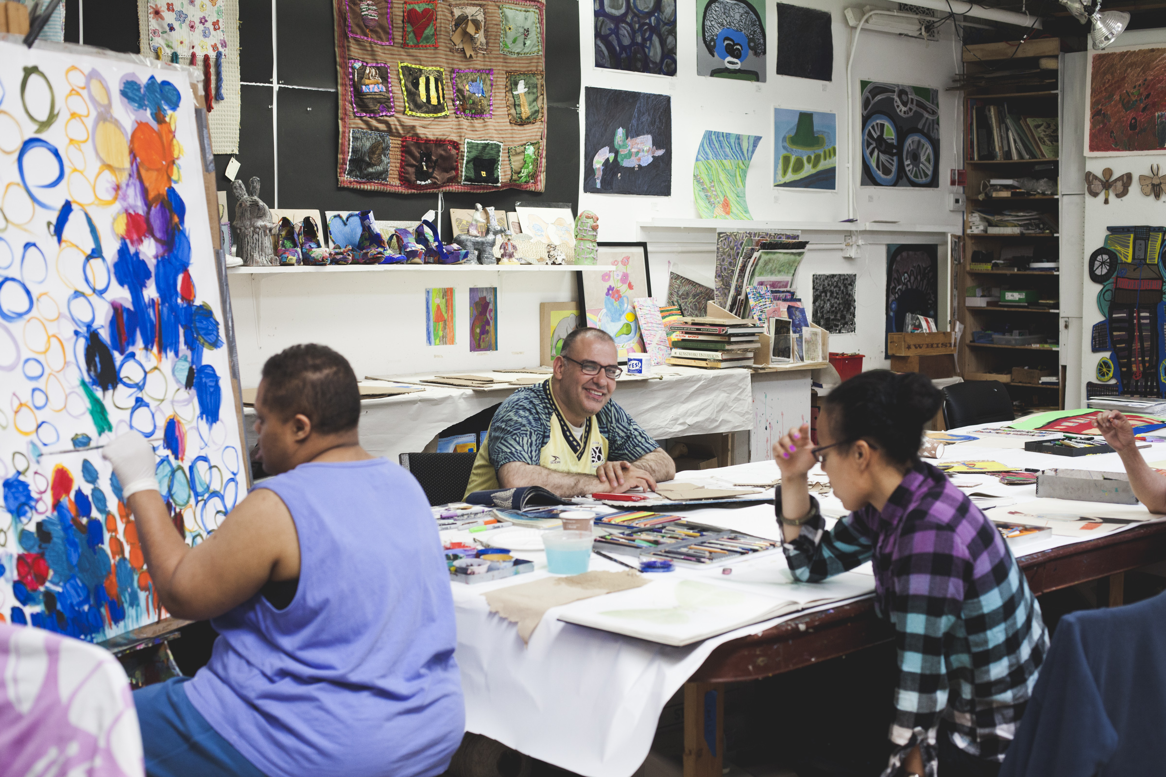 Creativity Explored artists Taneya Lovelace, Hector Lopez, and Musette Perkins.