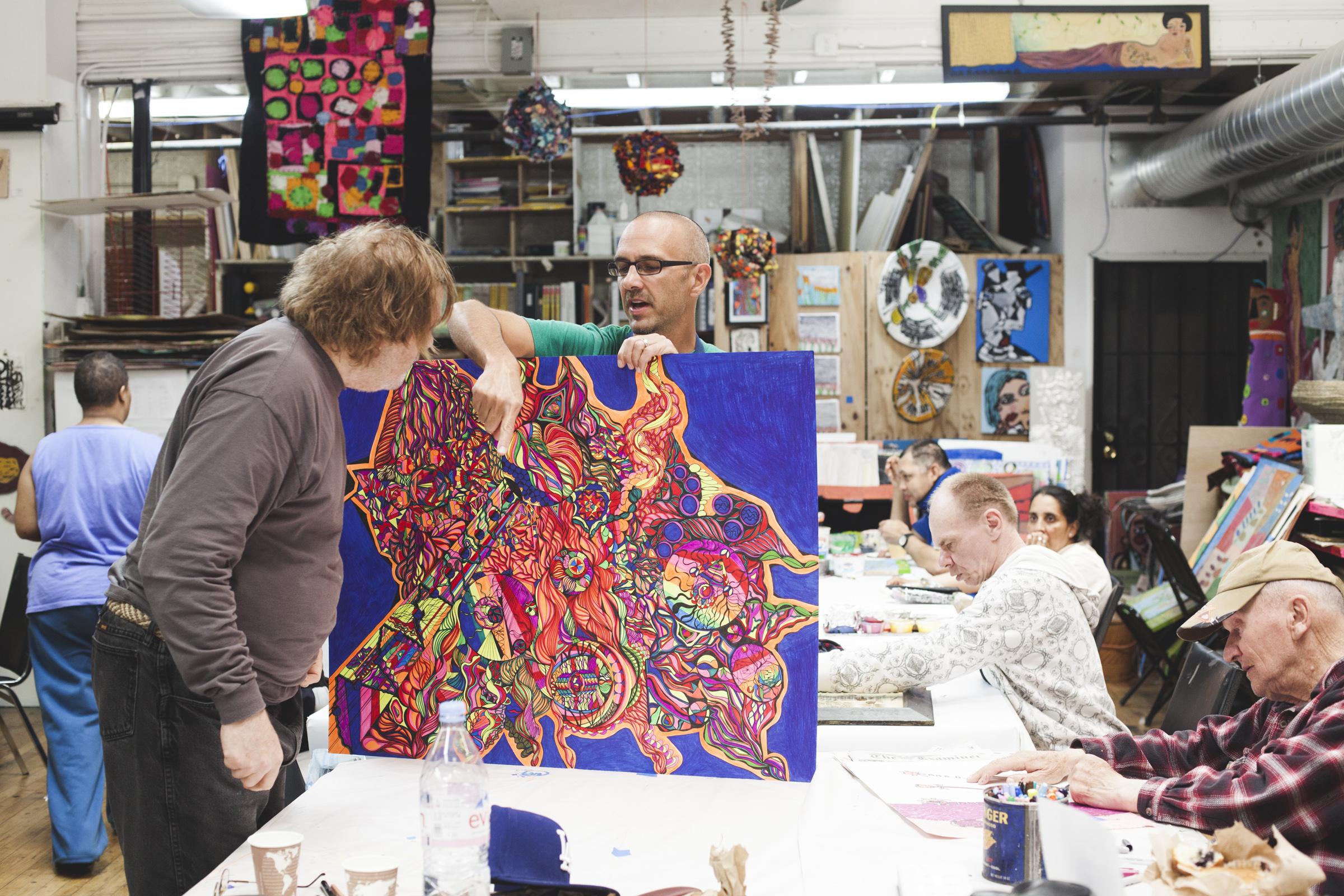Creativity Explored artist Dan Michiels with Visual Arts Instructor Eric Larson