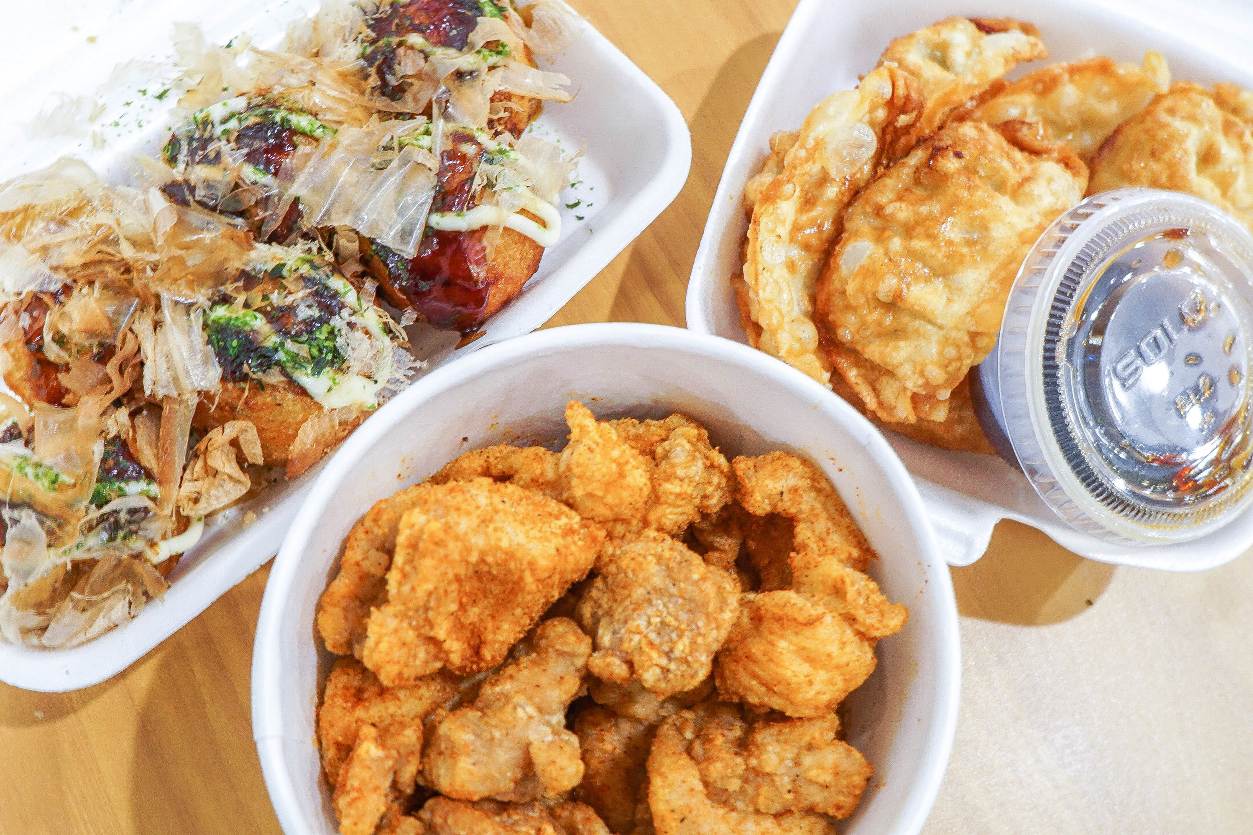 Clockwise: Takoyaki, Gyoza, and Popcorn Chicken