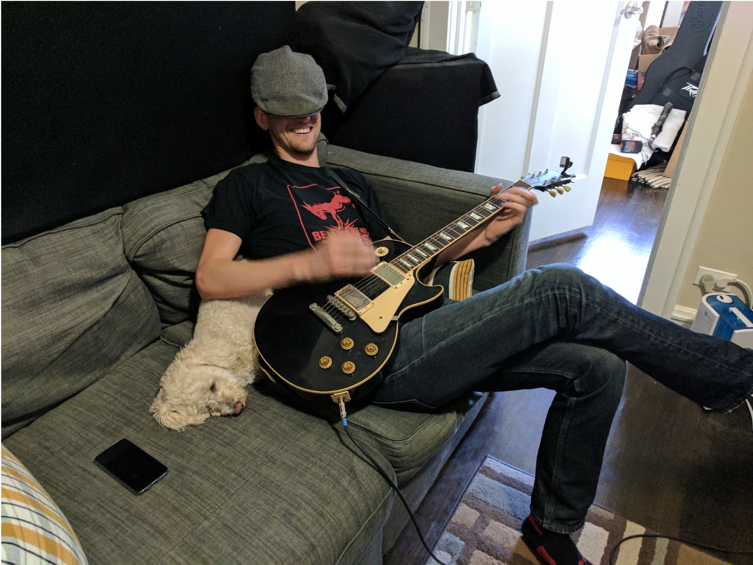 Curtis Weigel recording guitar with dog