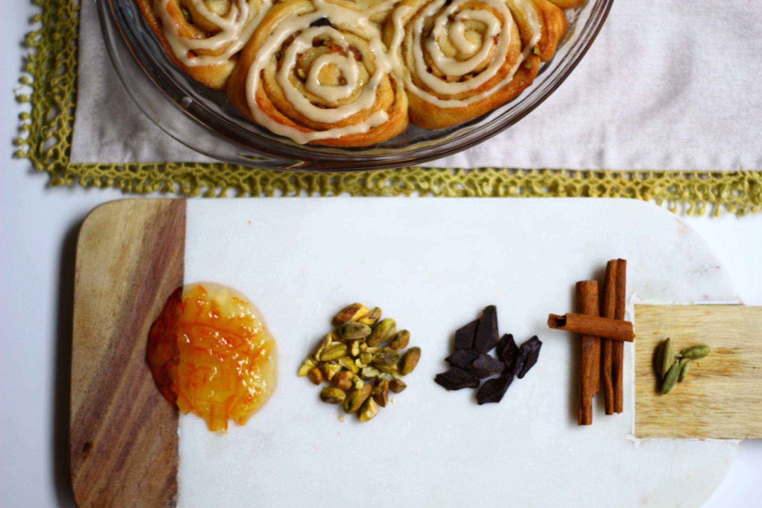 SWEET ORANGE ROLLS WITH CARDAMOM, CHOCOLATE, AND PISTACHIO